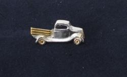Hopeinen kuorma-auto-pinssi